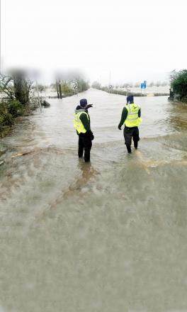 Al-Imdaad Foundation UK workers survey the scenes in Somerset