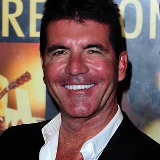 Simon Cowell is one of I Can't Sing! The X Factor Musical's financial backers