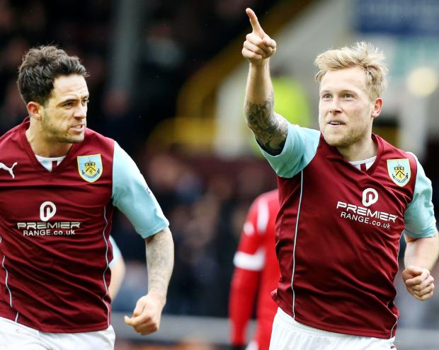 Scott Arfield celebrates his opening goal with Danny Ings