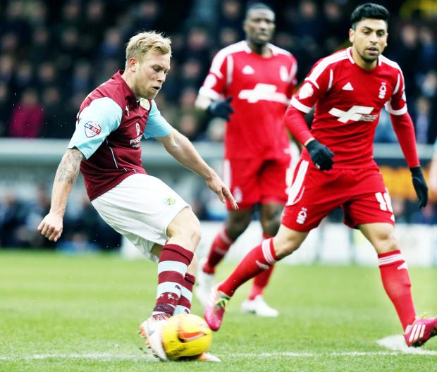 Scott Arfield strikes for the Clarets, who were just like Barcelona according to Dave Burnley