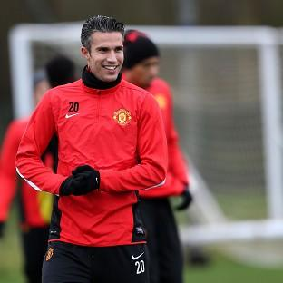 Manchester United's Robin Van Persie believes 10 teams have a chance of winning the Champions League
