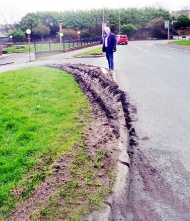 Coun Butterworth inspects the latest damage to the grass outside the Morris Dancers pub, in Colne
