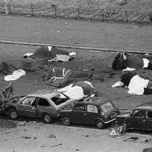 Dead horses and wrecked cars at the scene of an IRA bomb which exploded as the Household Cavalry was passing in Hyde Park, London, in 1982