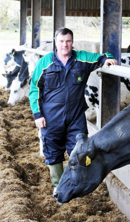 Farmer Paul Threlfall with one of his calving cows
