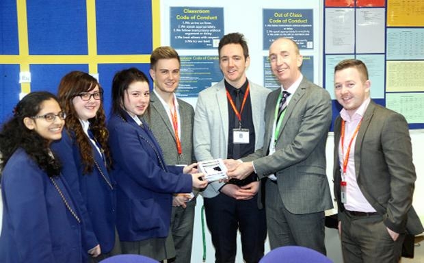 From left, Year 10 students Mirisha Patel, Megan Frost, and Bethany Cunliffe, with New Call head of correspondence Jonny Sims, business development manager Jonny Wardrobe, CEO Nigel Eastwood, and Young Enterprise's Jonathan Schofield