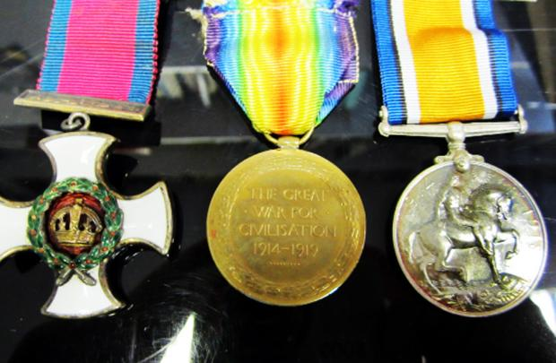 Percy Peat's three medals up for auction next week and, below, on duty in the First World War