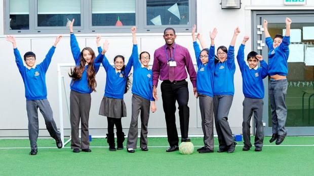 Lenny Johnrose with pupils from St Silas