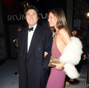 Bryan Ferry and Amanda Sheppard arrive at the Love Ball at the Roundhouse in Camden.