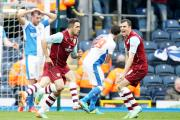 Dean Marney and Danny Ings celebrate Burnley's derby win