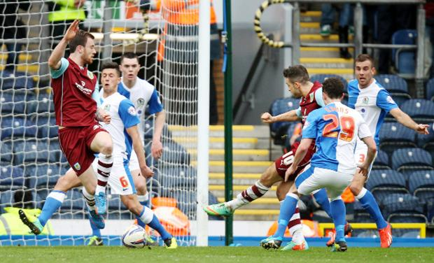 Lancashire Telegraph: Rovers loanee Michael Keane, third from left, can do nothing to stop Danny Ings netting the derby winner