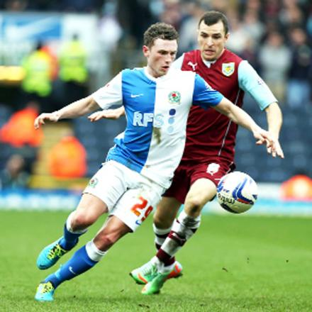 Rovers midfielder Corry Evans battles with Burnley's Dean Marney