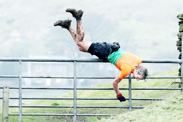 No barriers – an athlete jumps over a gate during the race