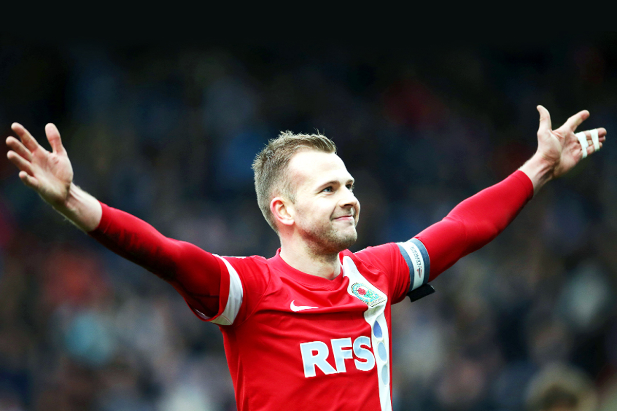 Rovers ace Jordan Rhodes celebrates his hat-trick at Huddersfield on Saturday Picture: CLIVE LAWRENCE