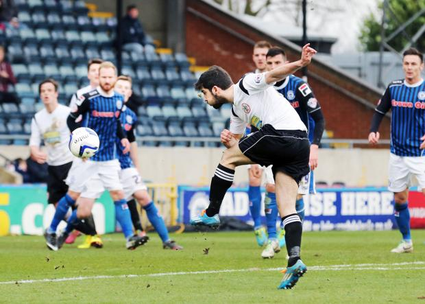 Goal-getter Piero Mingoia smashes home his stunner at Rochdale