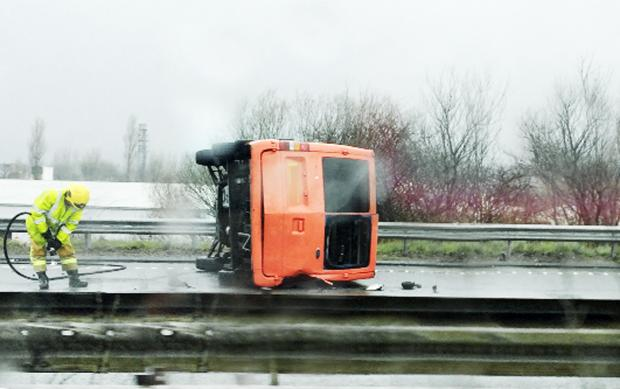 An overturned van on the motorway