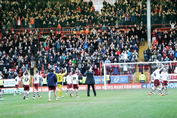 Lancashire Telegraph: Burnley salute their fans after the game at Charlton