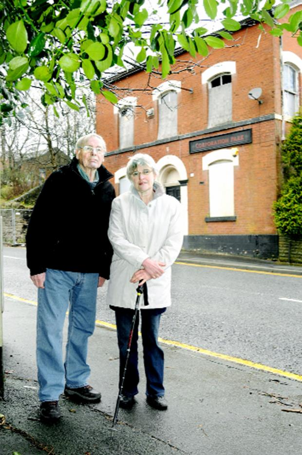 Lancashire Telegraph: Mike and Martha Chamberlin outside the empty derelict Corporation Park pub
