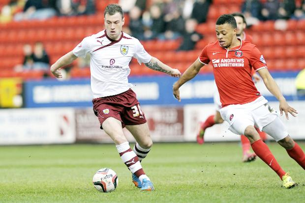 Lancashire Telegraph: Ashley Barnes on the ball for Burnley in the win over Charlton – when the striker opened his Clarets account