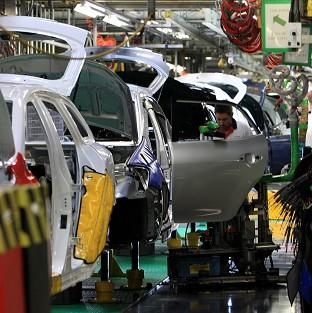 An engineer working on the production line at the Toyota plant, Burnaston, near Derby.