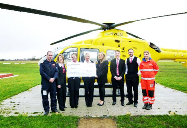 Representatives from Marsden Building Society present the cheque to the North West Air Ambulance