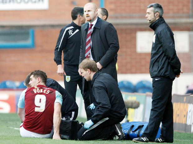Sam Vokes is treated pitchside on Saturday