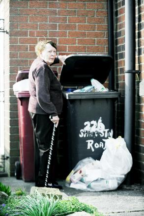 Mavis Reece with the overflowing bins