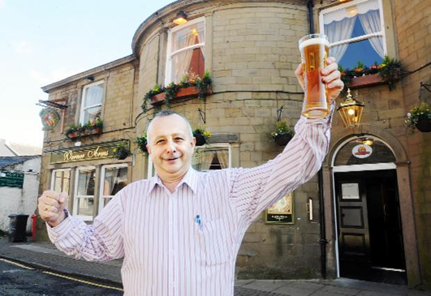 Operations director of Bravo Inns, Mark Dean, raises a glass to the new-look Warner Arms