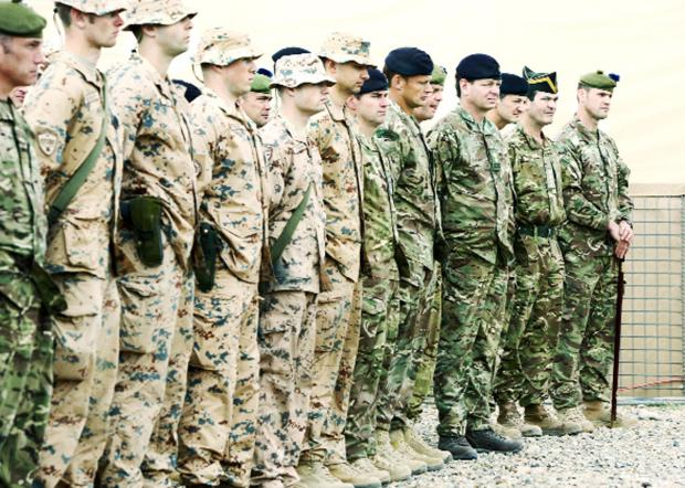 Lancashire Telegraph: Soldiers on parade at the Task Force Helmand merger ceremony at Camp Bastion