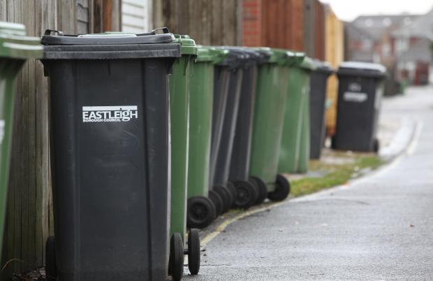 Wheelie bins awaiting collection