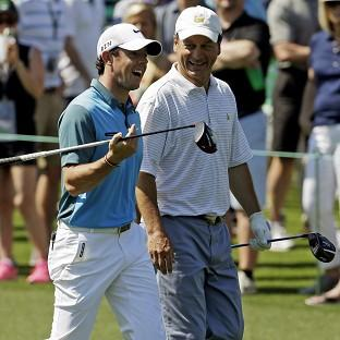 Rory McIlroy, left, carded a third-round 71 at the Masters (AP)
