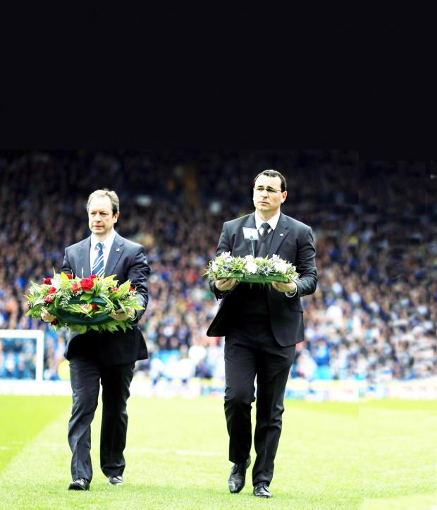 Lancashire Telegraph: Rovers boss Gary Bowyer and Owls chief Stuart Gray lay wreaths in memory of the 96 who died at  illsborough