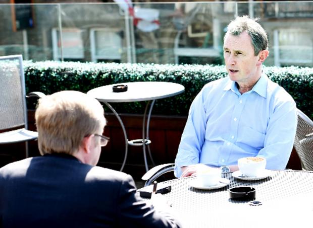 Nigel Evans is animated as he talks to reporter Bill Jacobs
