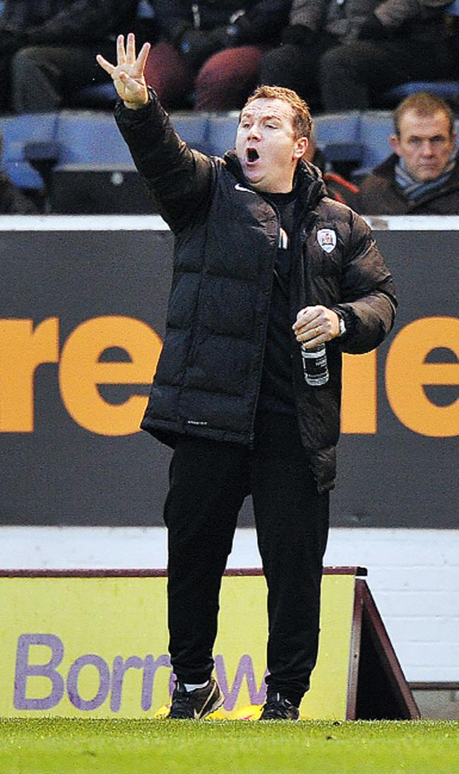 Five more points will do it – Micky Mellon wants Burnley to keep calm in the promotion race