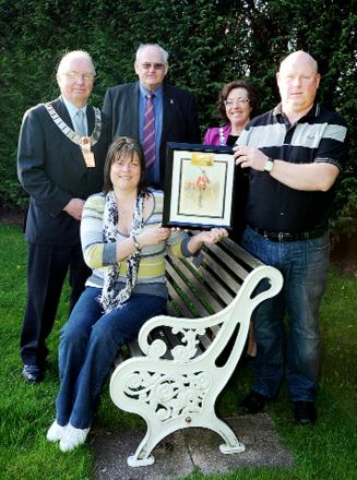 From left, Mayor Richard Sherras, Malcolm Smith, Mayoress Lyn Pate,  and Andy Matthews, and Michelle Pointez, front, with the painting