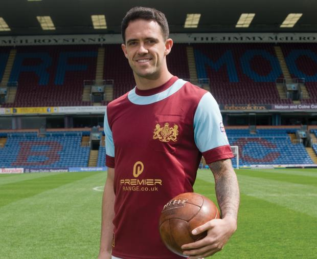 Danny Ings models the centenary shirt