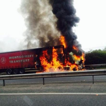 Two-hour delays on M61 after pet food lorry catches fire