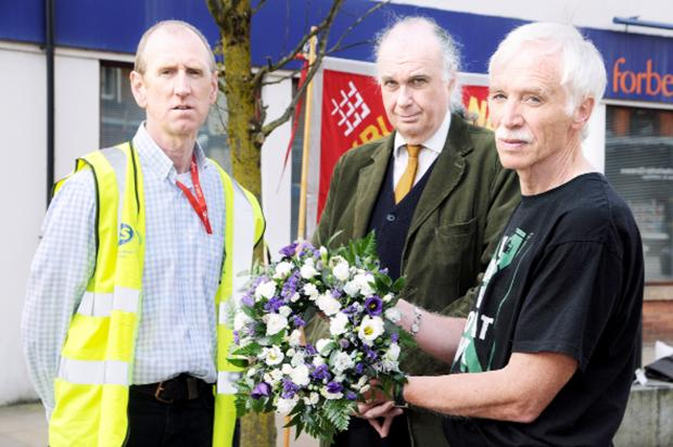 At the memorial ceremony  are, from left, Alan McShane, leading rep UCU Health and Safety Blackburn College, Ian Callagher, secretary of Blackburn and District Union Council, and John Murphy, president of Blackburn and District Union Council