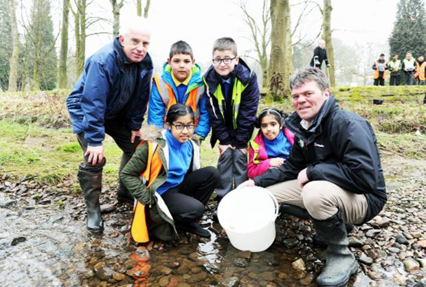 From left, volunteer Steve Johnson, with pupils from St Peter's, Tahir Bakhst, Jannath Chowdury (front), Kaleem Shah and Isha Hussain and trust enforcement officer Neil Ashworth