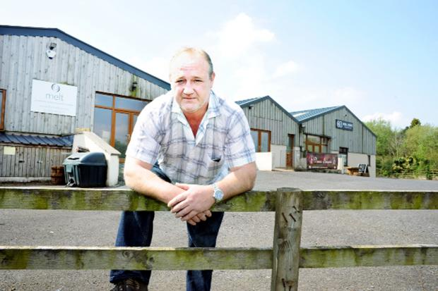 Owner Richard Drinkall outside the business barns at Backridge