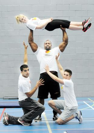 A lift from Mark Felix for 8½-stone Sarah Collinson, watched by Nadeen Akhtar, 18, and Tom Eyre, 19.