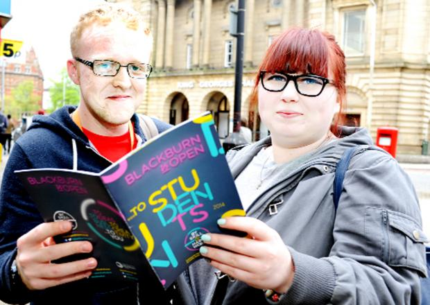 Curtis Baron, 21, and Cassie Bestwick, 18, check out the booklet