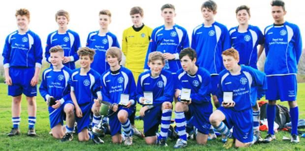 The talented Athletico Knuzden team who have won another league title