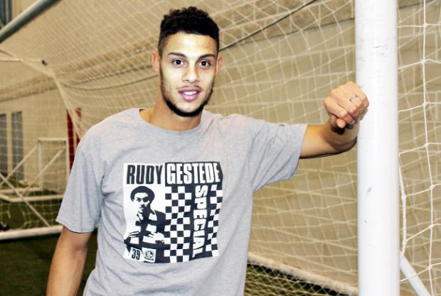Striker Rudy Gestede models one of the t-shirts made in his honour
