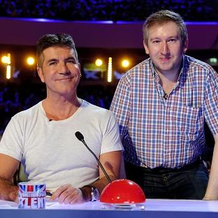 Contestant Simon Cowell with Simon Cowell on the ITV television programme Britain's Got Talent.