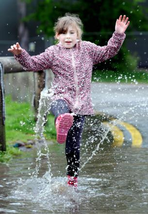 Following some heavy showers over the weekend, eight-year-old Olivia Davies enjoys splashing in some puddles in Witton Park.  Picture: JADE DOHERTY