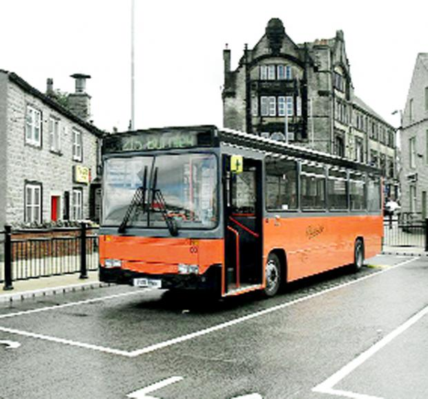 Lancashire Telegraph: Pennine Motors' orange and black buses have been a familiar sight on roads for many decades