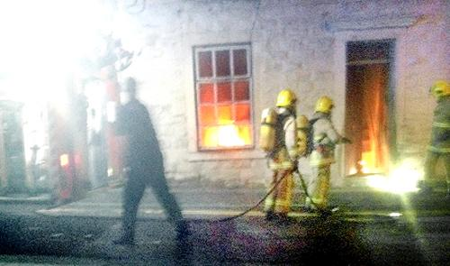 The house in Royds Street, Accrington, on fire