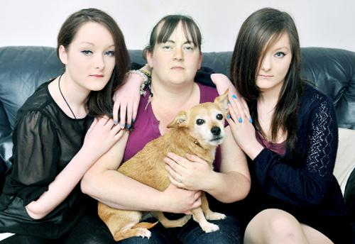 Lancashire Telegraph: Becky  Morrisey, with twin nieces Chloe and Alicia Morrisey and pet dog Deef after their traumatic experience with the burglary carried out as they were sleeping