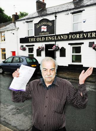 Landlord John Hodgkiss outside the Old England Forever with the council warning letter he receiv
