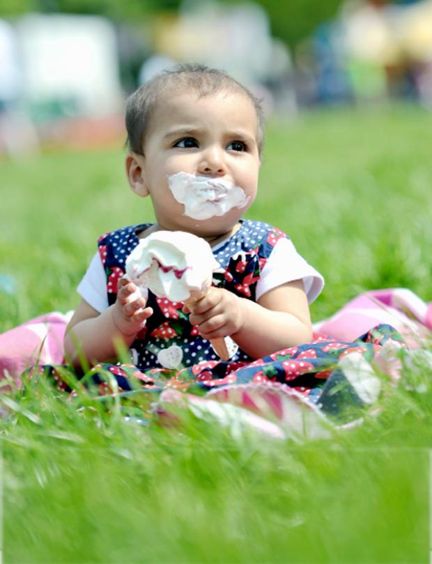 Lancashire Telegraph: Eight-month-old Kinza Hussain looks like she's thoroughly enjoying her ice cr
